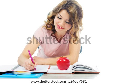 Happy female student studying on floor isolated on white background