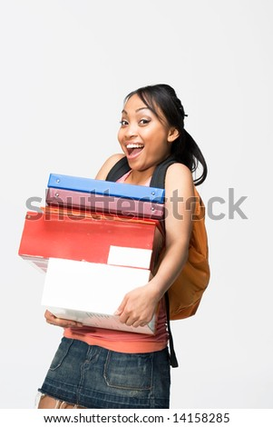 Happy female student wearing a backpack carries notebooks and papers. Vertically framed photograph. - stock photo