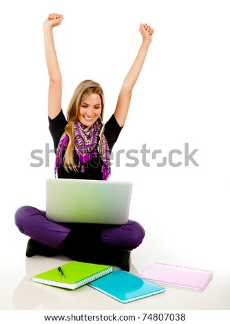 Happy female student with a laptop and arms up - stock photo