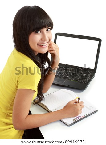 Happy female student with a laptop and notebooks . isolated over white - stock photo