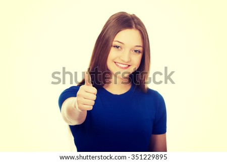 Happy female teenager showing thumbs up. - stock photo