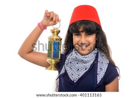 Happy Female Teenager with Red Fez Holding Ramadan Lantern Isolated on White Background - stock photo