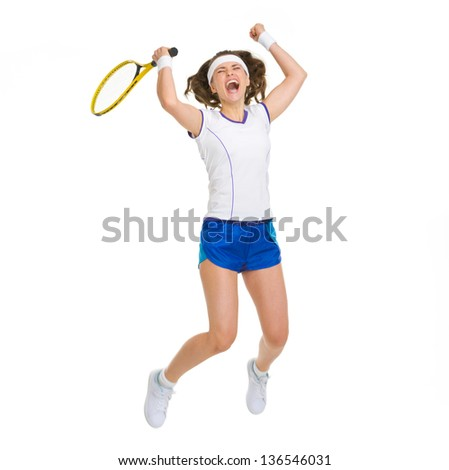 Happy female tennis player jumping - stock photo