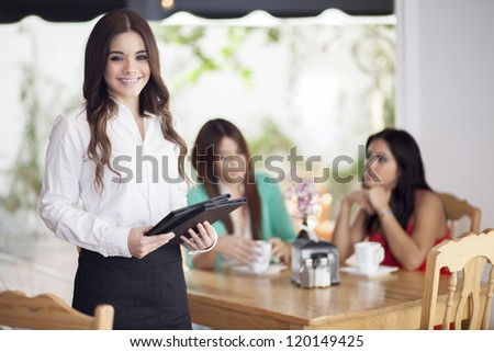 Happy female waitress loving her job and taking care of their customers