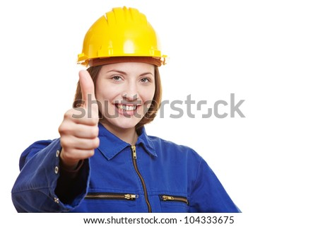 Happy female worker in overall holding thumbs up - stock photo