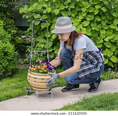 Happy female working in garden in summer