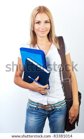 Happy female, young pretty teen student, girl holding books,  portrait - stock photo