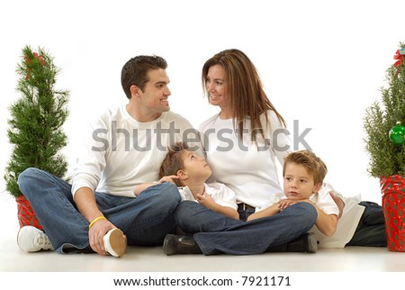 Happy, festive holiday portrait of a young attractive family - stock photo