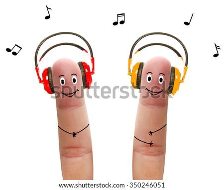 Happy fingers listen to music in headphones - stock photo