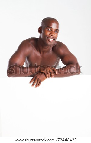 happy fit african american man behind white board - stock photo