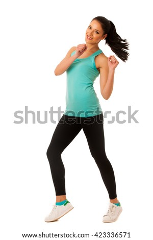 Happy fit and slim woman dancing and jumping isolated over white background - stock photo