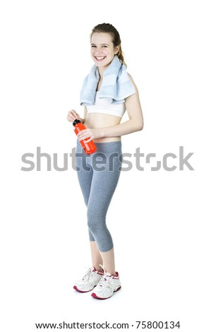 Happy fit young woman after workout with towel and water bottle - stock photo