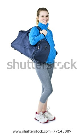 Happy fit young woman with gym bag standing ready for fitness exercise - stock photo