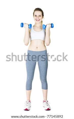 Happy fit young woman working out with weights standing on white background - stock photo