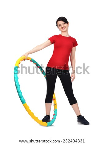 happy fitness girl with color hula hoop - stock photo