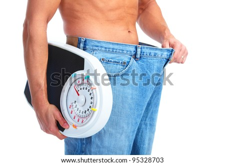 Happy Fitness man with a scales. Isolated on white background. - stock photo