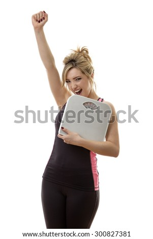 happy fitness woman holding scales - stock photo