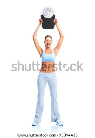 Happy Fitness woman with a scales. Isolated on white background.