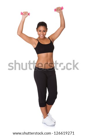 Happy Fitness Woman With Pink Dumbbells. Isolated On White - stock photo