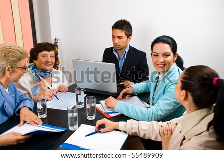 Happy five business people  having  conversation and working at  meeting - stock photo
