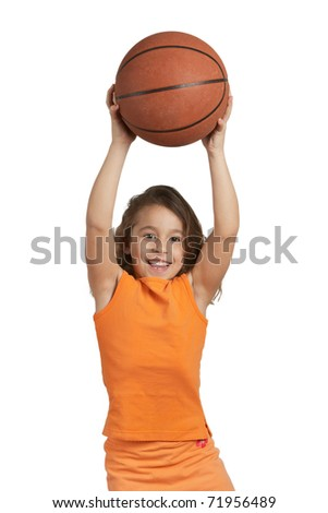 Happy five year old girl playing with basketball - stock photo