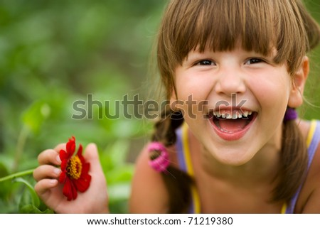 Happy five years Girl laughing outdoors headshot - stock photo