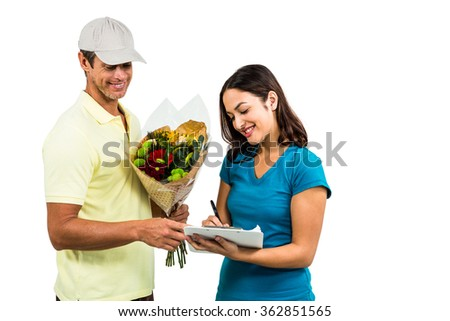 Happy flower delivery man taking signature of beautiful woman against white background - stock photo