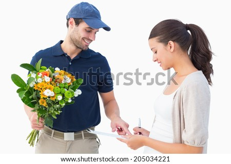 Happy flower delivery man with customer on white background - stock photo