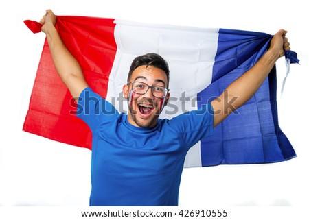 Happy football fan holding france flag  - stock photo
