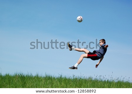 happy football player on sky background - stock photo