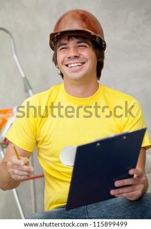Happy foreman explaining something - stock photo