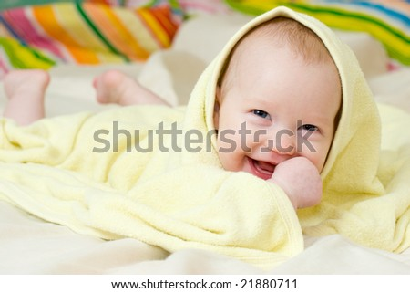 Happy four month baby girl in towel - stock photo