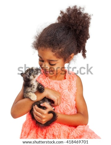 Happy four year old girl and kitten looking at each other. Isolated on white. - stock photo