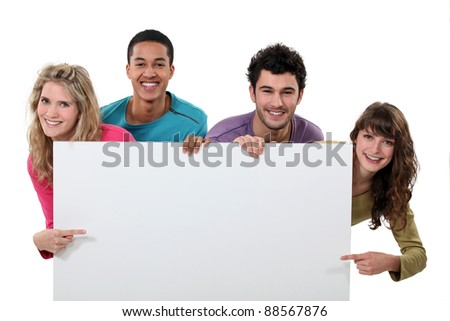 happy foursome showing copyspace - stock photo
