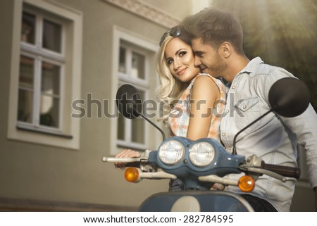 Happy free freedom couple driving scooter on summer date  - stock photo