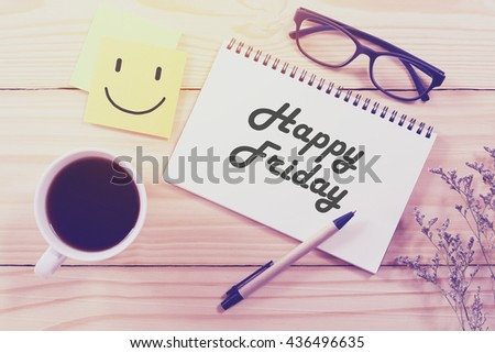 Happy Friday notebook and coffee cup on wooden table with vintage filter - stock photo
