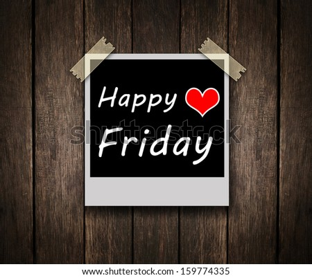 Happy Friday on grunge wooden background with copy space