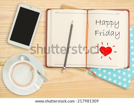 Happy Friday on notebook with pencil, smart phone and coffee cup - stock photo