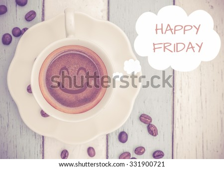 Happy Friday with coffee cup on table   - stock photo