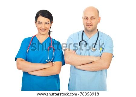 Happy friendly doctors team standing with arms folded isolated on white background