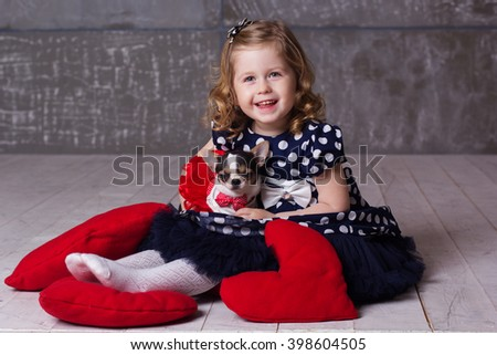 Happy friends child girl and chihuahua playing at home - stock photo