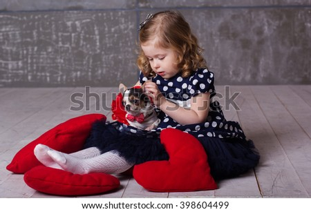 Happy friends child girl and dog are playing at home - stock photo