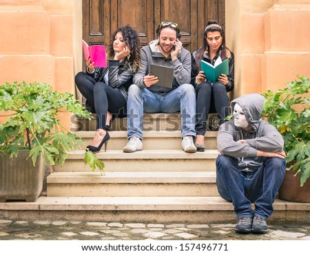Happy Friends during a University Break with a masked outcast Person - stock photo
