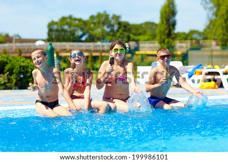 happy friends eat ice cream and enjoy summer in pool - stock photo