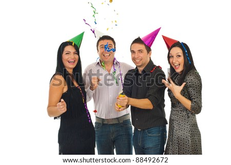 Happy friends having fun and opening tube with streamers and confetti  at party  over white background,selective focus on woman with red cone
