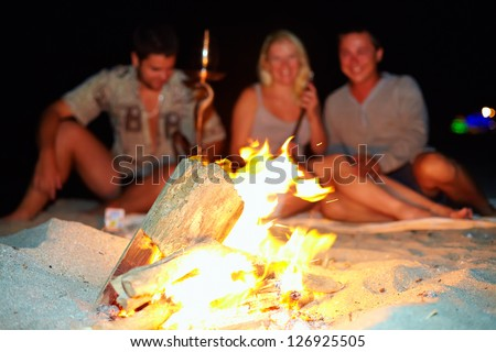 happy friends having fun around the bonfire - stock photo