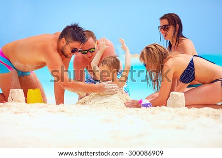 happy friends having fun in sand on beach, summer vacation - stock photo