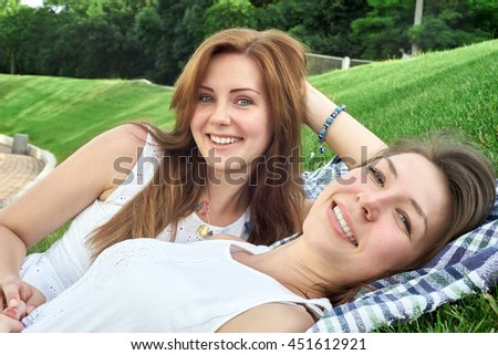 Happy friends in the park - stock photo