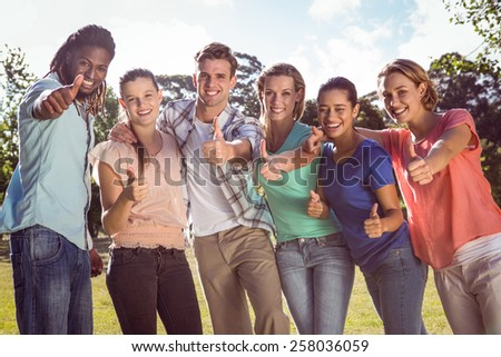Happy friends in the park on a sunny day - stock photo