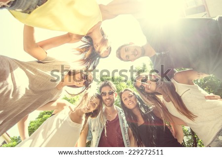 Happy friends making a circle - Group of students having fun - stock photo
